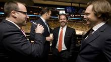 Ice Edge Holdings chairman Keith McCullough, second from right, laughs while joking with partners, from left to right, CEO Anthony LeBlanc, COO Daryl Jones, and CFO Todd Jordan in a suite at the ACC during NHL regular season action between the Phoenix Coyotes and Toronto Maple Leafs on Wednesday, December 16, 2009. Darren Calabrese for The Globe and Mail (Darren Calabrese)