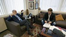 Former Foreign Affairs and Defence Minister Bill Graham speaks with his son Patrick Graham about the Iraq war, 10 years later, in the father's Toronto office. (Deborah Baic/The Globe and Mail)