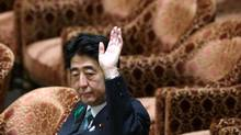 Japanese Prime Minister Shinzo Abe has questioned his country's pacifist constitution. (Bloomberg)