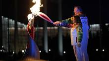 Irina Rodnina and Vladislav Tretiak light the Olympic cauldron during the opening ceremony of the 2014 Winter Olympics in Sochi, Russia, Friday, Feb. 7, 2014. (Matt Slocum/AP)