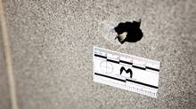 A bullet hole is seen in the wall inside the entrance way at 2468 Eglinton Avenue West were a male youth was shot in the leg during a drive-by. (Anne-Marie Jackson/The Globe and Mail/Anne-Marie Jackson/The Globe and Mail)