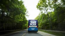 The Ontario Progressive Conservative Party bus travels along Highway 20 en route to a campaign stop in Fenwick, Ont., on May 28. (Aaron Lynett/THE CANADIAN PRESS)