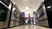 A woman walks by stoves in the appliance section at a Sears store in Schaumburg, Illinois near Chicago, September 23, 2013. (© Jim Young / Reuters/REUTERS)