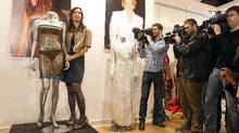 Charlotte Todd stands next to the dress she designed, and which was worn by Kate Middleton during a charity fashion show in 2002. (Alastair Grant/Alastair Grant/AP)