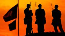 Confederate re-enactors stand on the ramparts of Fort Moultrie are silhouetted in the rising sun to mark the 150th anniversary of the Civil War on April 12, 2011 in Charleston, South Carolina. (Richard Ellis/Getty Images/Richard Ellis/Getty Images)