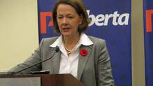 Alberta Premier Alison Redford speaks to reporters at the Alberta Progressive Conservative convention in Calgary on Saturday, Nov. 10, 2012. (Bill Graveland/The Canadian Press)