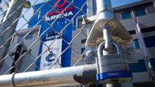 A padlock is seen on a parking lot gate outside Rogers Arena, the home of the Vancouver Canucks NHL hockey team, in Vancouver, B.C., on Sunday September 16, 2012. (DARRYL DYCK/THE CANADIAN PRESS)