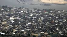 A cluster of houses is seen in Nigeria's Oil city of Port Harcourt March 24, 2011.REUTERS/Akintunde Akinleye (NIGERIA - Tags: SOCIETY) (AKINTUNDE AKINLEYE/AKINTUNDE AKINLEYE/REUTERS)