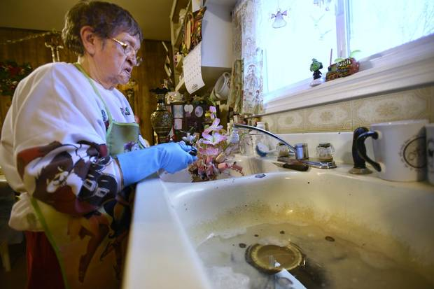 Serpent River First Nation resident Mildred Johnston uses tap water for washing up but uses bottled water for drinking and cooking.