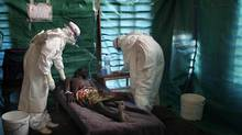 A September 2007 file photo shows staff of the medical charity Medecins Sans Frontieres treating a suspected Ebola patient in the isolation unit of Kampungu in Congo's Eastern Kasai province. (Pascale Zintzen/MSF/REUTERS)
