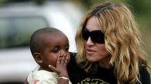 Madonna with her adopted son (Karel Prinsloo/Karel Prinsloo/AP)