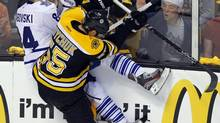 Toronto Maple Leafs center Mikhail Grabovski (L) is checked by Boston Bruins defenseman Johnny Boychuk in the third period of Game 1 of their NHL Eastern Conference quarterfinals hockey playoff series in Boston, Massachusetts May 1, 2013. (BRIAN SNYDER/REUTERS)