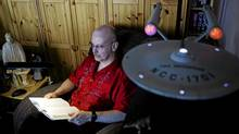 Robert J. Sawyer in his Mississauga living room: The space is adorned with science-fiction memorabilia. (Michelle Siu/The Globe and Mail)