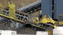 A bulldozer dumps coal at the Brooks Run Mining Co., owned by Alpha Natural Resources, in Cucumber, W.V. (Jon C. Hancock/Bloomberg)