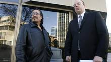 Rob Sinclair, left, cousin of Brian Sinclair, a homeless man who died after a 34-hour wait in an emergency ward, and Vilko Zbogar, Toronto-based lawyer for the Sinclair family, are shown outside the Winnipeg Law Courts on Nov.17, 2009. (Mike Deal/The Canadian Press)