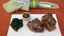 Lamb chops with tomato pesto and spinach (Deborah Baic/The Globe and Mail)