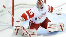 Detroit Red Wings goalie Ty Conklin blocks a shot against the Colorado Avalanche during the first period on Sunday, Dec. 4, 2011. (Jack Dempsey/The Associated Press/Jack Dempsey/The Associated Press)