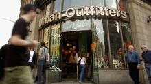 Pedestrians pass in front of Urban Outfitters on 6th Ave. and 14th street in Manhattan.