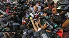 V.K. Anand, centre, lawyer for Ram Singh, speaks with the media at the hospital where Singh's body is scheduled to arrive for autopsy in New Delhi March 11, 2013. (Adnan Abidi/REUTERS)
