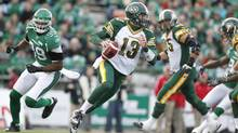 Edmonton Eskimos quarterback Mike Reilly runs up the ball while playing against the Saskatchewan Roughriders during the first half of their CFL game in Regina, Saskatchewan November 2, 2013. (DAVID STOBBE/REUTERS)