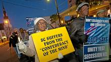 NAACP protesters march against the Secession Ball on the 150th anniversary of South Carolina?s secession from the Union on December 20, 2010 in Charleston, SC. South Carolina was the first state to secede in a process that led to the U.S. Civil War. (Richard Ellis/Getty Images)