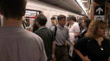 Commuters return to their regular routines Monday morning on the Toronto subway. Most workers in the city were expected back at work for the first time since the blackout last Thursday and the transit system was ready to take them there. (Darryl James/ The Globe and Mail/Darryl James/ The Globe and Mail)