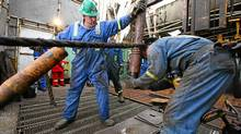 Workers on a Precision Drilling Corp. oil rig tap into North Dakota's Bakken formation. (Nathan VanderKlippe/The Globe and Mail)