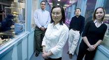 Allison Mitchell, a corporate recruiting specialist with Dalsa, a Canadian imaging specialty company, with three recent hires - all new Canadians: Feng Hua Feng, front, Yun Lin, back right, and Sukhbir Singh Kullar, back left. (Peter Power/Peter Power/The Globe and Mail)