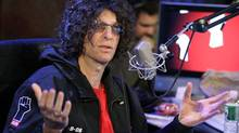 Radio personality Howard Stern responds to a question at an on-air news conference during his debut show on Sirius Satellite Radio, in New York, Monday Jan. 9, 2006. (Richard Drew/AP)