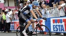 Ryder Hesjedal, of Canada, pedals during the 19th stage of the Giro d'Italia, Tour of Italy cycling race, from Treviso to Val di Fiemme, Italy, Friday, May 25, 2012. (Gian Mattia D'Alberto/AP/Gian Mattia D'Alberto/AP)