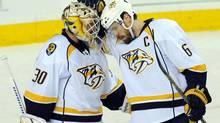 Nashville Predators goalie Carter Hutton and defenseman Shea Weber celebrate their win (Candice Ward/USA Today Sports)