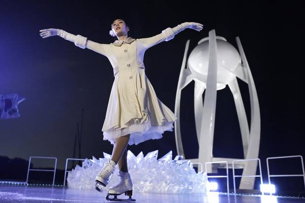 South Korean Olympic figure skating champion Yuna Kim performs before lighting the Olympic flame during the opening ceremony of the 2018 Winter Olympics in Pyeongchang, South Korea, on Friday.