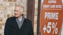 NDP leader Jack Layton arrives at a campaign event in Brantford, Ont., on March 29, 2011. Mr. Layton announced his plan to limit credit card fees for consumers and small businesses. (GEOFF ROBINS/Geoff Robins/AFP/Getty Images)