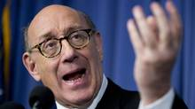 Kenneth Feinberg, the independent claims administrator for the General Motors Ignition Compensation Program, announces the details of the program, including eligibility, scope, rules for the program, and timing of submitting claims, during a news conference at the National Press Club in Washington, Monday, June 30, 2014. (MANUEL BALCE CENETA/THE ASSOCIATED PRESS)
