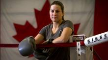 Canadian boxer and Olympic hopeful Mary Spencer poses for a portrait at her home gym in Windsor, Ont. March 13/2012. (Kevin Van Paassen/The Globe and Mail)