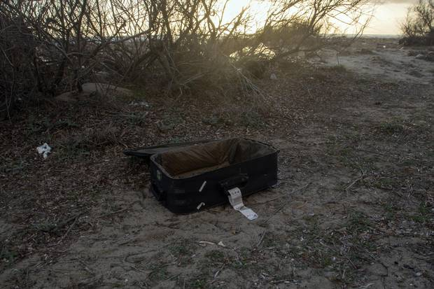 An abandoned suitcase on Dikili beach in Turkey. Many refugees make the dangerous crossing to the Greek island of Lesbos from here, looking for a path into Europe.