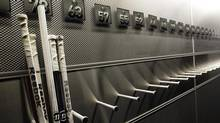 A nearly empty hockey stick rack is shown in Buffalo, N.Y., Tuesday, Sept. 25, 2012. (David Duprey/AP)