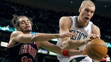 Boston Celtics' Greg Stiemsma, right, grabs a rebound in front of Chicago Bulls' Joakim Noah (13) in the first quarter of an NBA basketball game in Boston. (Michael Dwyer/Associated Press)