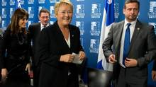 Quebec Premier Pauline Marois, centre, is all smiles after she announced the nomination of Environment Minister Yves Francois Blanchet, right, and Veronique Hivon, left, to regain her junior Social Services cabinet, Dec. 4, 2012, in Quebec City. (Jacques Boissinot/THE CANADIAN PRESS)