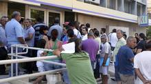 Crowds of jobless gather outside a local employment office in Nicosia July 3, 2012. (ANDREAS MANOLIS/REUTERS)