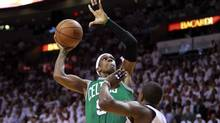 Boston Celtics' Rajon Rondo (L) shoots over Miami Heat's Mario Chalmers in the fourth quarter during Game 5 of their Eastern Conference Finals NBA basketball playoffs in Miami, Florida June 5, 2012. (Andrew Innerarity/REUTERS)