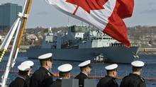Sailors look on as HMCS Charlottetown heads out to sea in Halifax on March 2, 2011. (ANDREW VAUGHAN/THE CANADIAN PRESS)