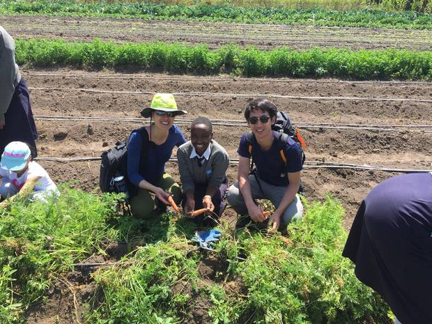 Elaine Chin, left, Kisaruni student and Robert Wong visit the Oleleshwa Farm, located near the site of Kisaruni Girls Secondary School – Oleleshwa Campus, in Kenya.