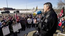 AUPE President Guy Smith talks to the crowd during a wildcat strike outside the Royal Alexandra hospital in Edmonton on February 16, 2012. (Jason Franson For The Globe and Mail)