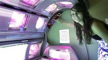 Rosie McDavid, 17, who has been using tanning beds since she was 14, prepares a tanning bed for a session, Wednesday, March 25, 2009, in Tallahassee, Fla. (Phil Coale / The Associated Press/Phil Coale / The Associated Press)