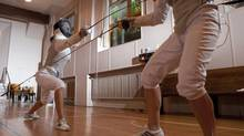 Instructor Katya Belkina, left, spars with one of her students during My Fencing Club's practice at the Community of Christ church in Toronto on Tuesday, July 3, 2012. (Matthew Sherwood for The Globe and Mail)