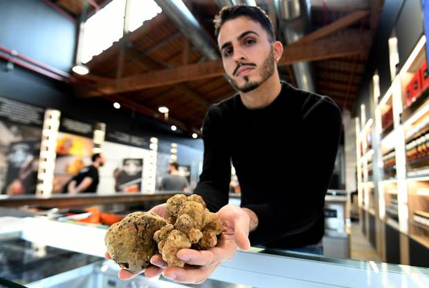 A vendor presents truffles at a stand during a press tour at FICO Eataly World agri-food park in Bologna on November 9, 2017. FICO Eataly World, said to be the world's biggest agri-food park, will open to the public on November 15, 2017.