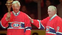Montreal Canadiens greats Jean Beliveau (left) and Maurice (Rocket) Richard exchange a torch during closing ceremonies after the final game at Montreal Forum, Monday, March 11, 1996. Former great Ken Dryden writes that although Richard was the most legendary player of all-time, he was not much more than average size. He possessed no blinding speed, no overpowering shot. The lingering image of him now more than 50 years after his last game is his eyes. Wide, wild, his pupils so focused on his task, to get to the net, they'd bore a hole through anything that stood in their way. (CP PICTURE ARCHIVE/Ryan Remiorz) (RYAN REMIORZ)