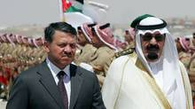 Saudi King Abdullah bin Abdul Aziz al-Saud (R) reviews the honour guard with Jordanian King Abdullah II (L) at Maraka airport in the Jordanian capital Amman, 28 June 2007. (Hassan Ammar/AFP/Getty Images/Hassan Ammar/AFP/Getty Images)