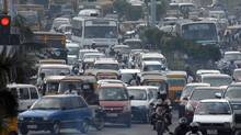 Traffic moves along a busy road in the southern Indian city of Chennai on Feb.1, 2011. (BABU/BABU/REUTERS)